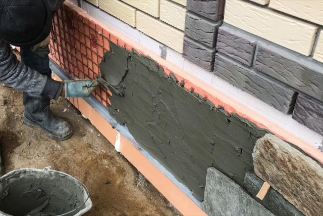 Brick Veneer Laying by worker