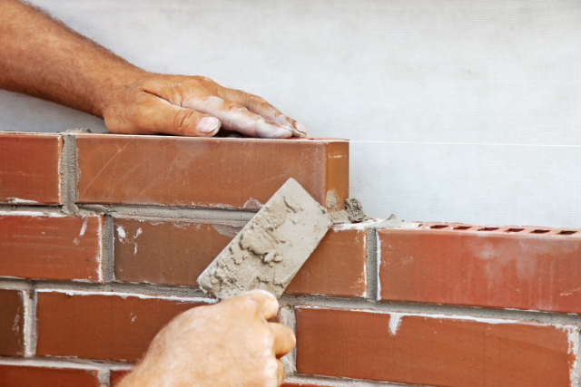 Worker Brick Laying In Eugene